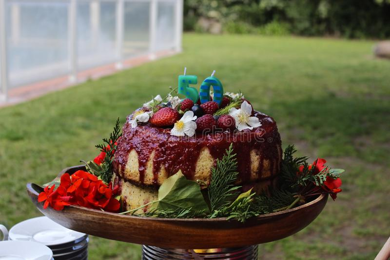 50 Flower Birthday Cake. A beautiful 50 birthday cake involved in flowers and fruits. A cake where the nature stands up stock photography