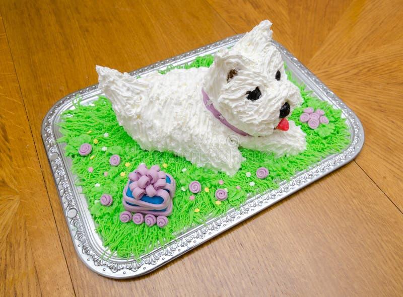 Beautiful birthday cake in shape of the white yorkshire terrier. Beautiful birthday cake in the shape of the white yorkshire terrier stock images