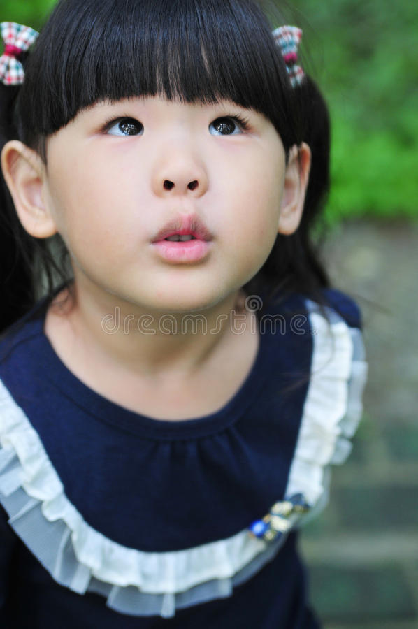 Beautiful black eyes of a Chinese little girl. Beautiful black eyes of a cute Chinese little girl royalty free stock images