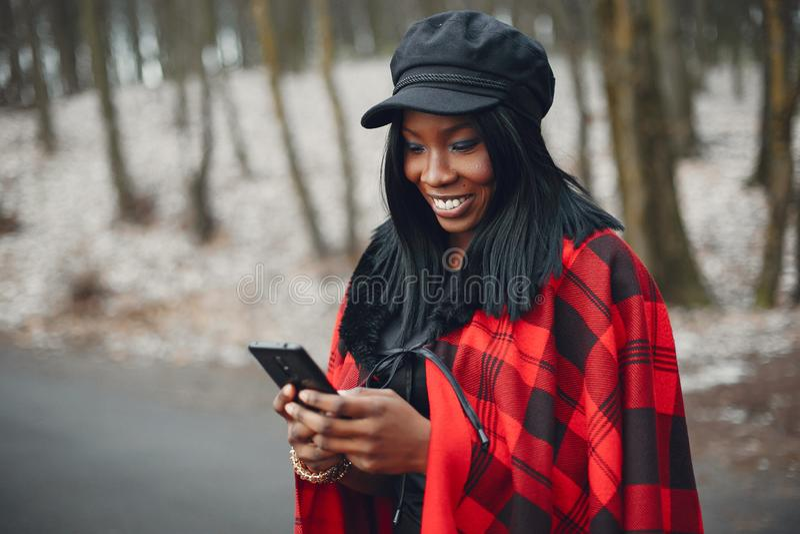 Elegant black girl in a winter park stock photography