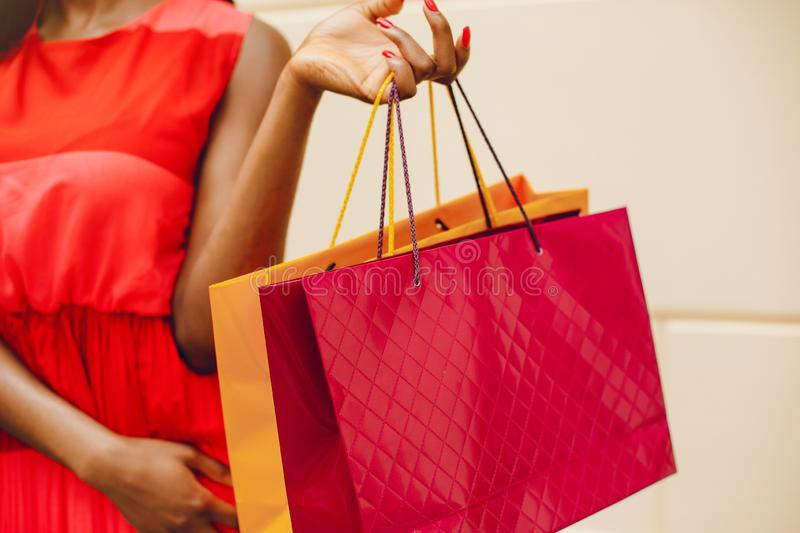 Beautiful black girl with shopping bags in a city royalty free stock photo