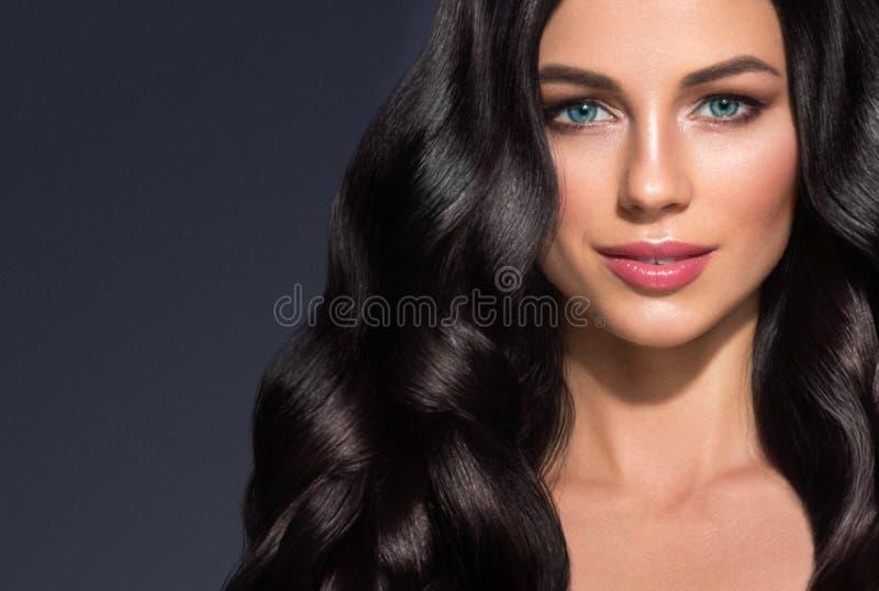 Beautiful Black hair woman beauty portrait. Amazing hairstyle fe. Male long curly shine hair. Studio shot royalty free stock image