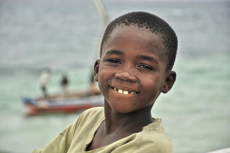 Beautiful black kid on the island in Mozambique royalty free stock image