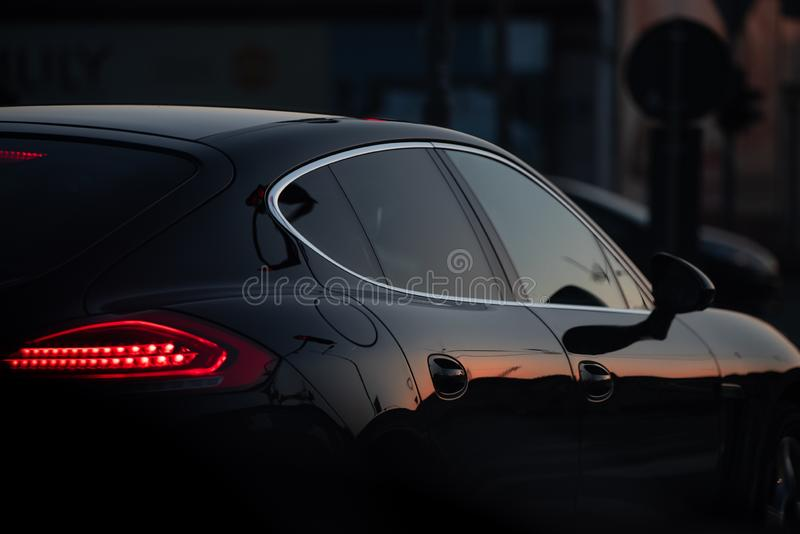 A beautiful black luxury car stuck in traffic royalty free stock images
