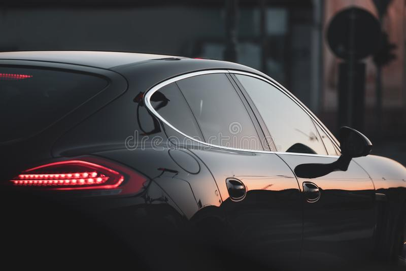 A beautiful black luxury car stuck in traffic royalty free stock photography
