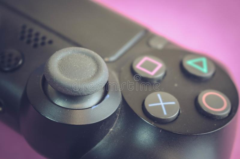 A beautiful black modern digital game joystick to control a video game console for video games with buttons and stick copy space royalty free stock photography