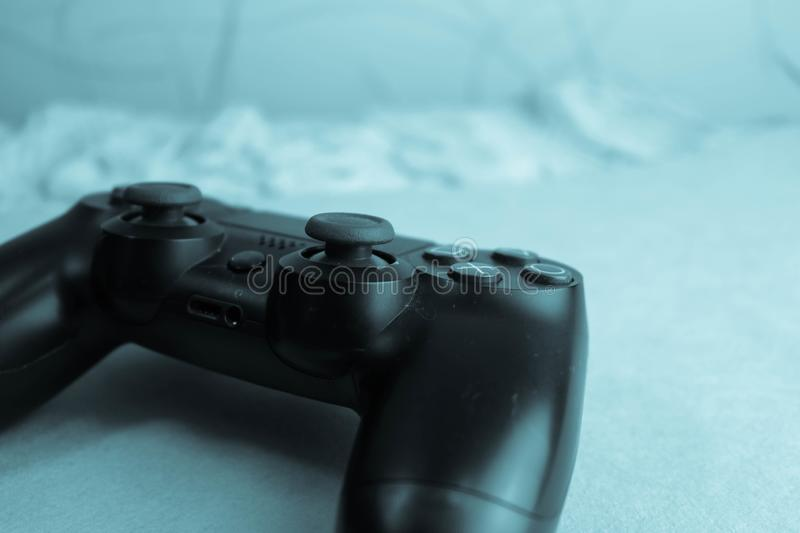 A beautiful black modern digital gaming joystick to control a video game console for video games with buttons and keystrokes royalty free stock photography