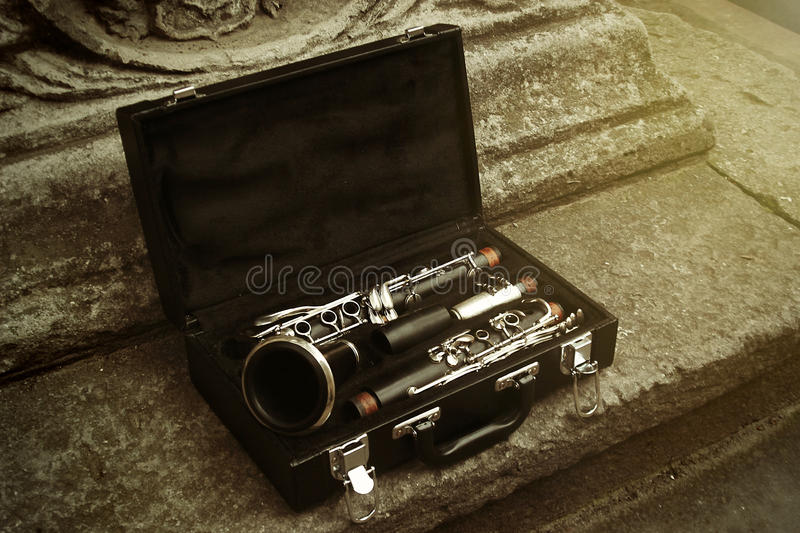 beautiful black and silver clarinet in classic case on background of old city, space for text royalty free stock photo