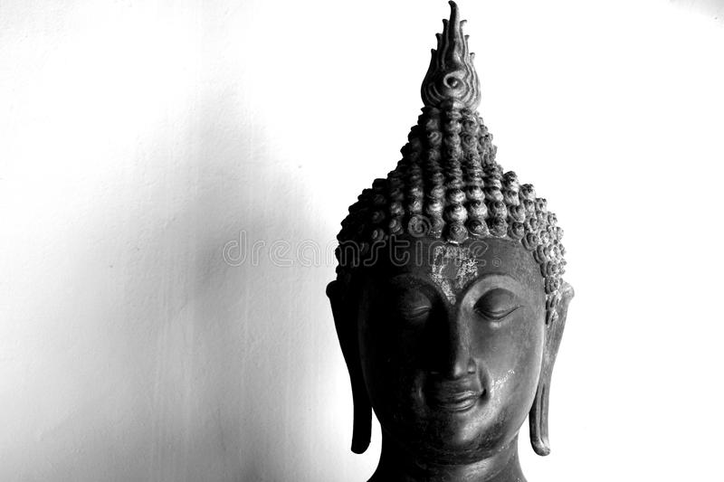 Beautiful black and white face of buddha royalty free stock image