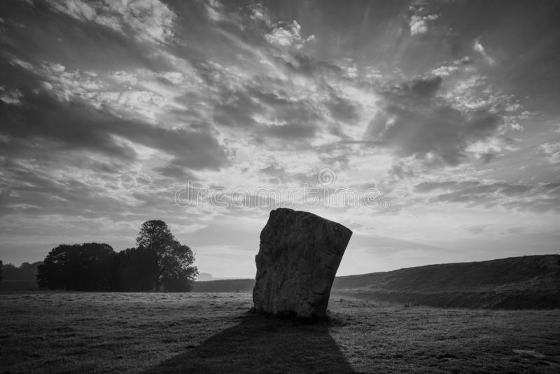 Stunning  black and white Summer sunrise landscape of Neolithic standing stones in English cluntryside with gorgeous light with royalty free stock photo