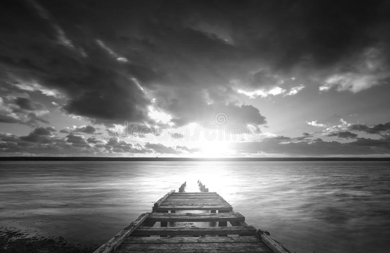 Beautiful black and white sunset landscape image of Fleet Lagoon royalty free stock photography