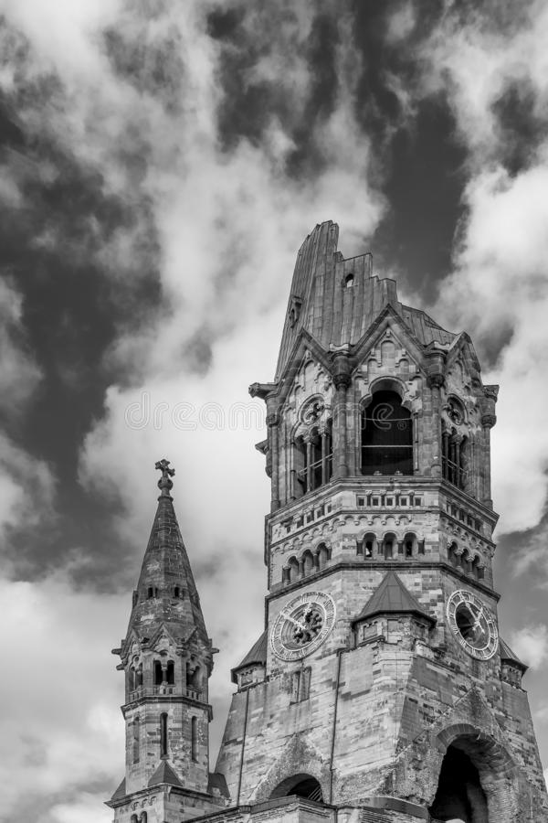 Beautiful black and white view of the destroyed bell tower of the Gedächtniskirche church in Berlin, Germany. Europe, against a dramatic sky royalty free stock images