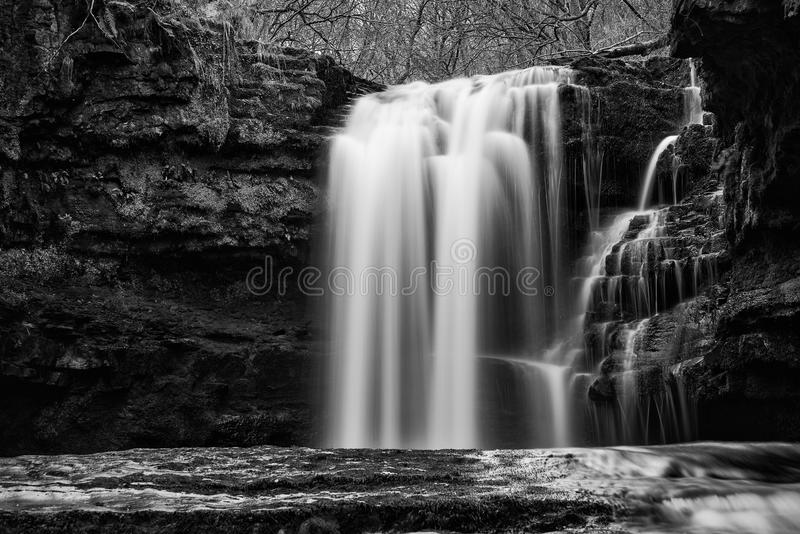 Beautiful black and white waterfall landscape image in forest du stock images