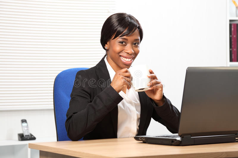 Download Beautiful Black Woman Drinks Coffee At Work Stock Photo - Image: 19021446