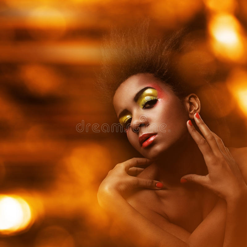 Beautiful black woman with glossy makeup royalty free stock photos
