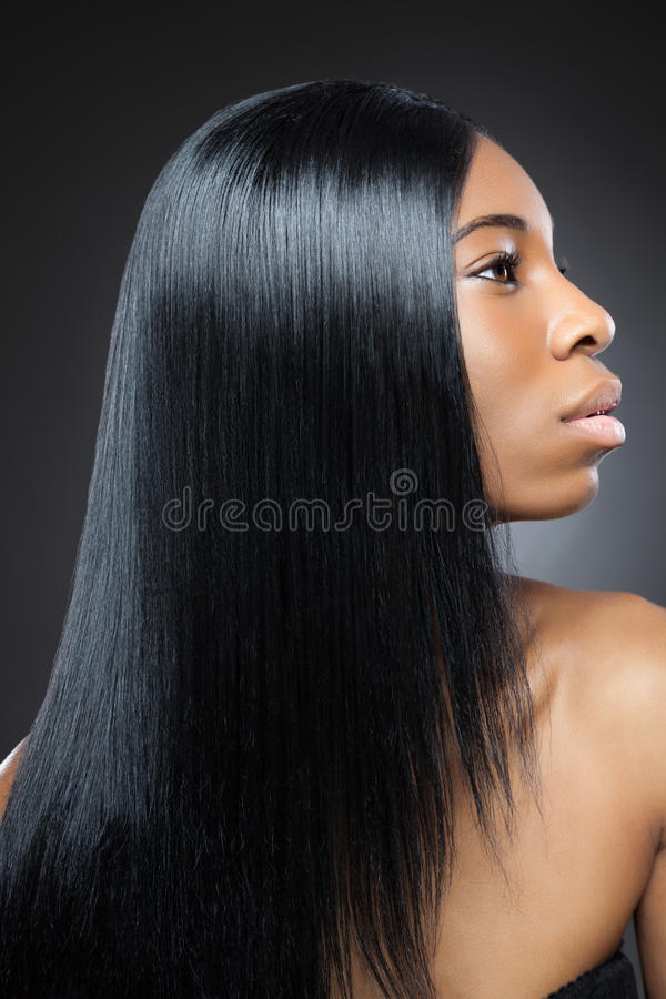 Beautiful black woman with long straight hair stock photography