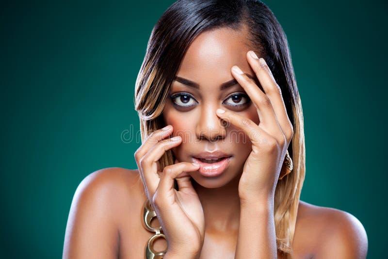 Beautiful black woman with perfect skin stock photos