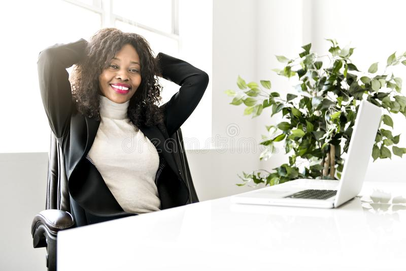 Beautiful black woman working on self employee office royalty free stock photos