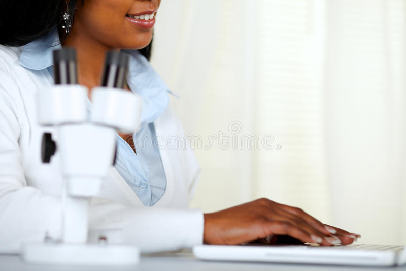 Beautiful black young woman working at laboratory