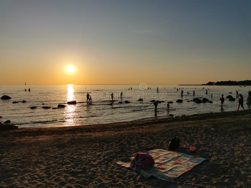 Beautiful blazing sunset landscape at Baltic Sea. Amazing summer sunset view on the beach in Estonia royalty free stock photos