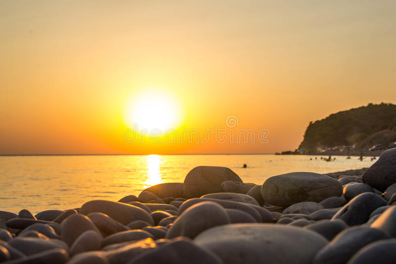 Beautiful blazing sunset landscape at black sea and orange sky above it as a background stock photo