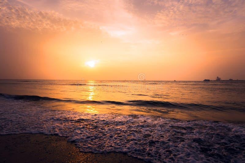 Beautiful blazing sunset landscape at black sea and orange sky stock image