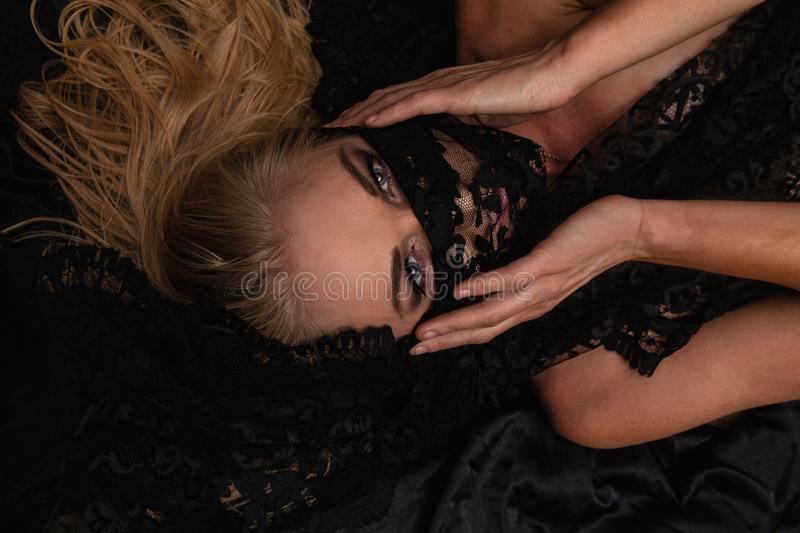 Beautiful blond with black lace stock photo