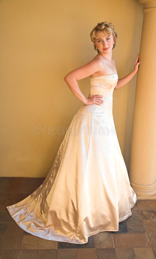 Beautiful blond bride in beige stock images