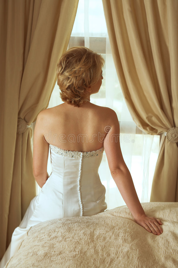 Beautiful Blond Bride In Satin Pearl Dress Royalty Free Stock Photography
