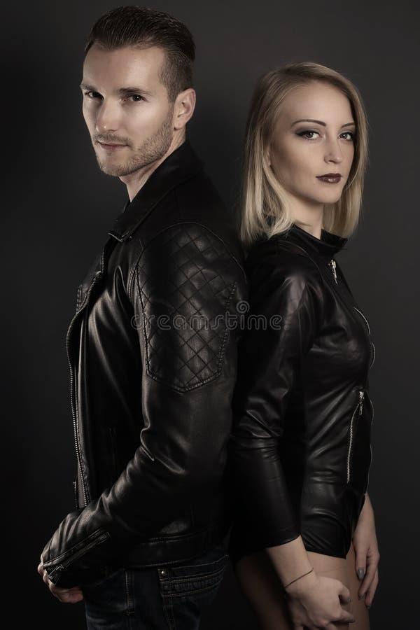 Beautiful blond couple posing stock image