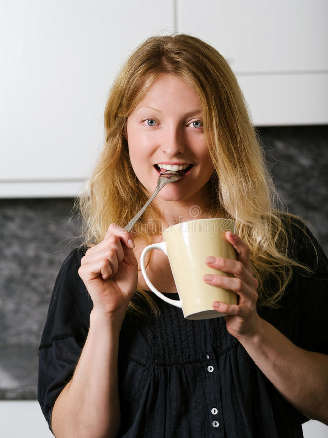 Beautiful blond enjoying coffee stock photo