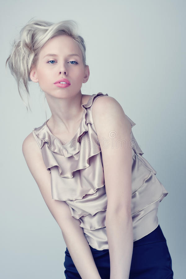 Beautiful blond fashion girl, silver top stock photography