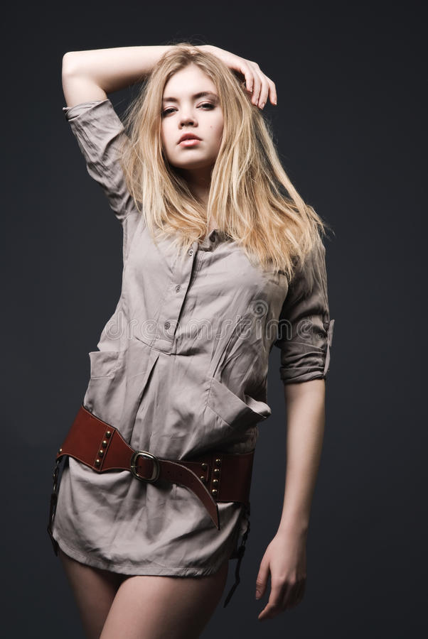 Beautiful blond fashion model with blowing hair royalty free stock photography