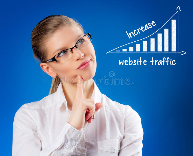 Beautiful blond female looking at SEO chart. royalty free stock photography