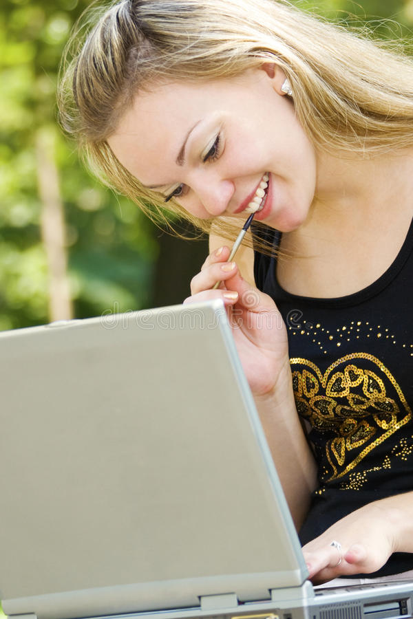 Free Beautiful Blond Female With Laptop Stock Image - 11281301