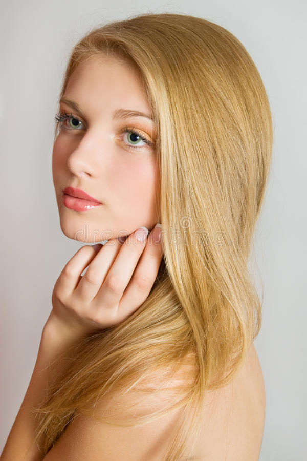 Beautiful Blond Girl. Blonde Hair. Face close up with perfect skin. Healthcare and beauty concept. Pretty woman portrait. royalty free stock photo