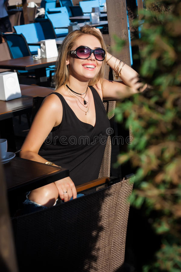 Beautiful blond girl in a cafe stock photos