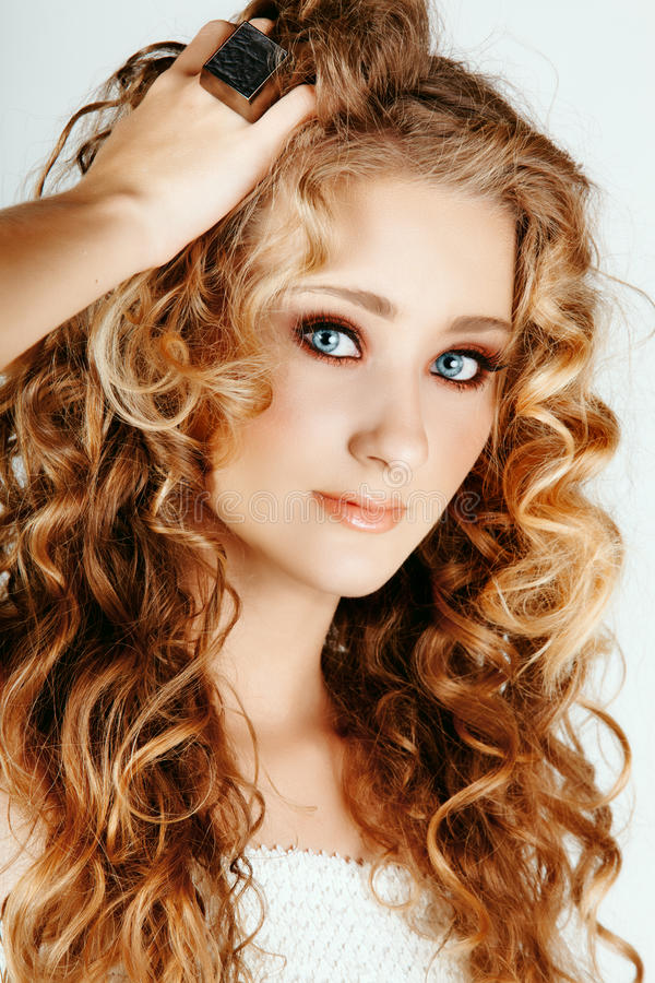 Beautiful blond girl with curly hair royalty free stock photo