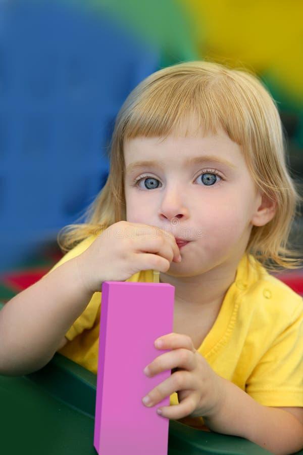 Download Beautiful Blond Girl Drinking Pink Juice Royalty Free Stock Photos - Image: 10987558