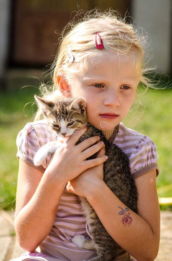 Happy child and animal cat together stock photos