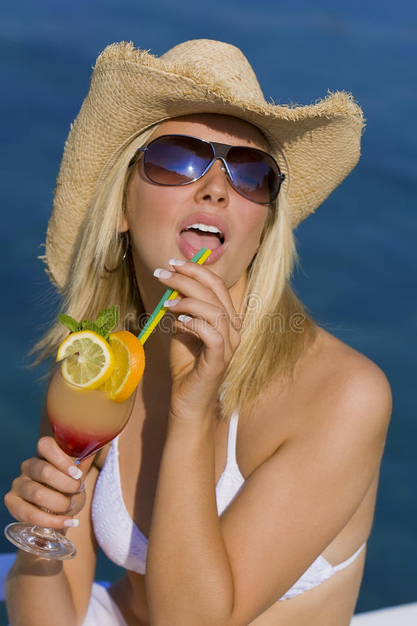 Free Beautiful Blond Girl In Bikini Drinking Cocktail Stock Photography - 12743762