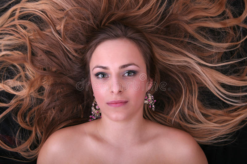 Beautiful Blond Girl Lying On Her Back Royalty Free Stock Images