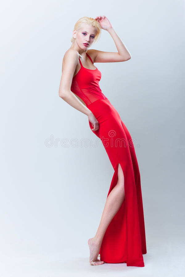 Beautiful blond girl in red dress stock photos