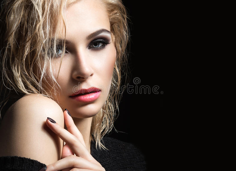 Beautiful blond girl with wet hair, dark makeup and pale lips. Beauty face. stock images