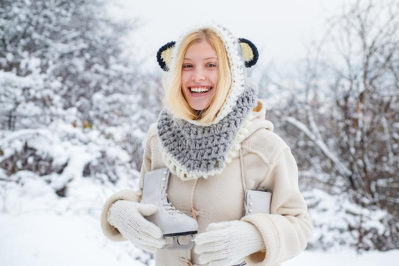 Beautiful blond hair girl i winter clothes outdoor. Funny young woman in the winter time. Beautiful pretty young woman stock images