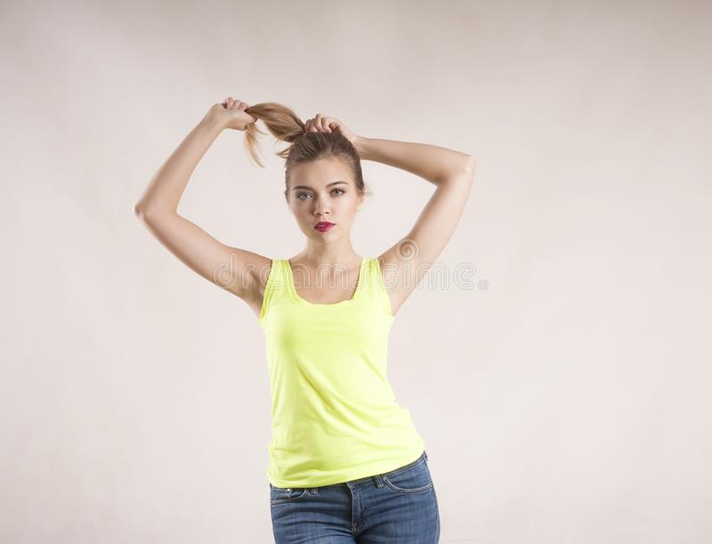 Beautiful blond hair girl pretty, healthy, expression studio, looking royalty free stock photography