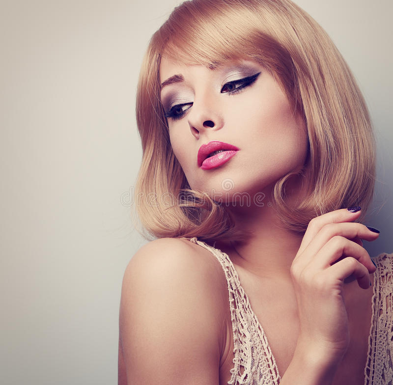 Free Beautiful Blond Makeup Woman With Short Hair Style Looking Down. Stock Image - 56782131