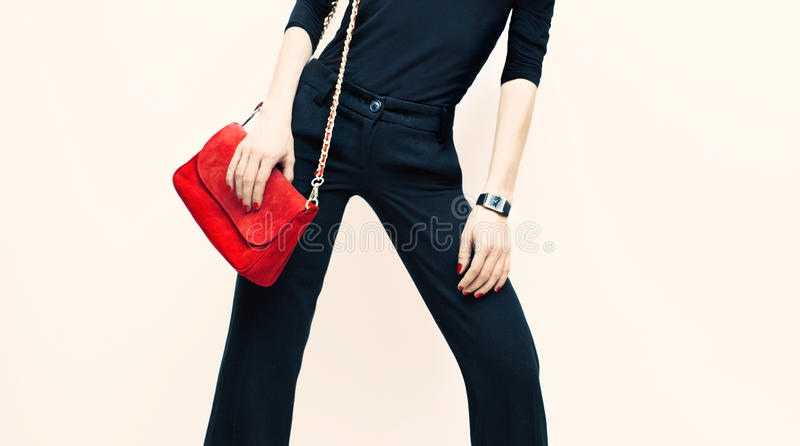 Beautiful blond model classic black style with red fashionable c. Lutch stock photo