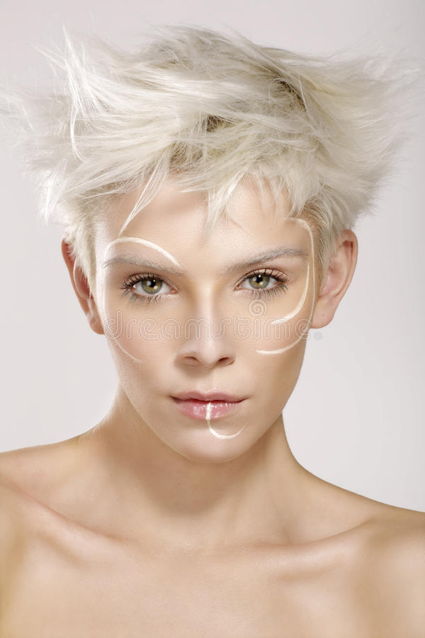 Beautiful blond model wearing elegant artistic makeup royalty free stock photography