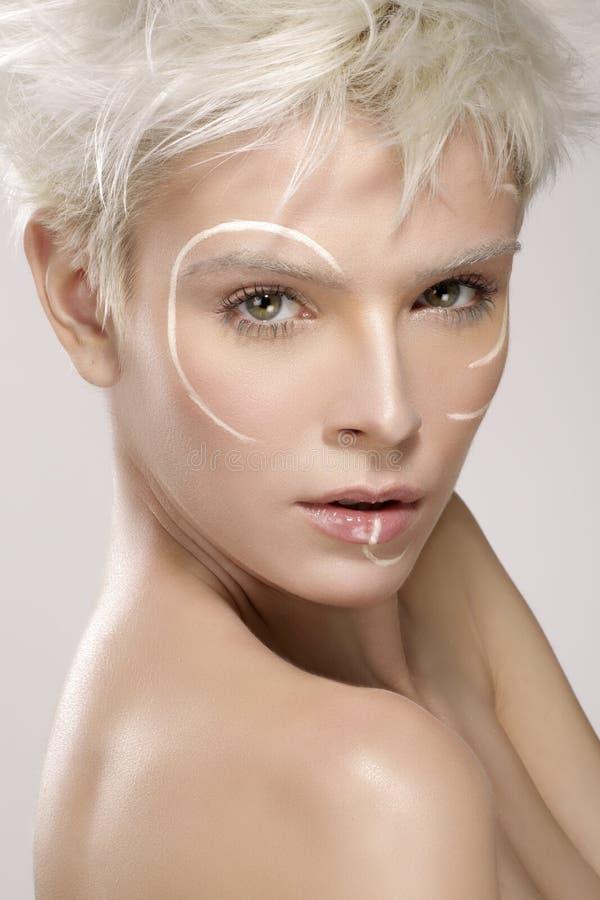 Beautiful blond model wearing elegant artistic makeup stock images